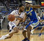 Nevada guard Corey Henson (2) drives the baseline against San Jose State forward Christian Anigwe (11) in the first half of an NCAA college basketball game in Reno, Nev., Wednesday, Jan. 9, 2019. (AP Photo/Tom R. Smedes)