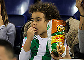 30th October 2017, Cornella-El Prat, Cornella de Llobregat, Barcelona, Spain; La Liga football, Espanyol versus Real Betis; A young Betis supporter eating chips as he watches the game