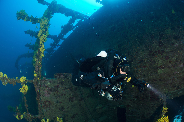 Divers exploring the wreck of the Brioni which lies between 40 and 65 metres