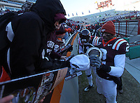 Nov 27, 2010; Charlottesville, VA, USA; Virginia Tech Hokies linebacker Davon Morgan (2) and Virginia Tech Hokies safety Antone Exum (1) sign autographs after the game gainst the Virginia Cavaliers at Lane Stadium. Virginia Tech won 37-7. Mandatory Credit: Andrew Shurtleff