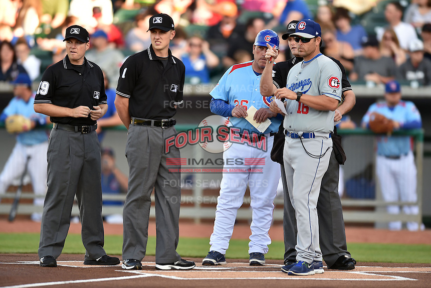 First base umpire Lew Williams (19), third base umpire Alex Ransom (1),  Tennessee Smokies manager Buddy Baily (26), home plate umpire Blake Carnahan and Chattanooga Lookouts manager Doug Mientkiewicz (16) before a game against the Chattanooga Lookouts on April 25, 2015 in Kodak, Tennessee. The Smokies defeated the Lookouts 16-10. (Tony Farlow/Four Seam Images)