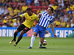 Andre Gray of Watford is challenged by Lewis Dunk of Brighton & Hove Albion during the premier league match at the Vicarage Road Stadium, Watford. Picture date 26th August 2017. Picture credit should read: Robin Parker/Sportimage