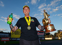Sep 3, 2016; Clermont, IN, USA; NHRA pro stock driver Aaron Strong celebrates after winning the postponed final round from the Seattle race that was rescheduled to run during qualifying for the US Nationals at Lucas Oil Raceway. Mandatory Credit: Mark J. Rebilas-USA TODAY Sports