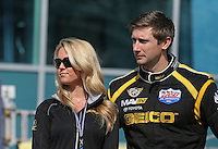 Mar. 17, 2013; Gainesville, FL, USA; NHRA top fuel dragster driver Morgan Lucas with wife Katie Lucas during the Gatornationals at Auto-Plus Raceway at Gainesville. Mandatory Credit: Mark J. Rebilas-