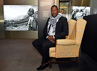 Nelson Mandela&rsquo;s grandson, Nkosi Zwelivelile Mandela sitting on Nelson Mandela's favourite yellow armchair from his home in rural South Africa, at Press view for exhibition celebrating the life and legacy of Nelson Mandela, the anti-apartheid revolutionary and former President of South Africa, showcasing personal belongings and objects. <br /> Nelson Mandela The Official Exhibition press view, London, UK - 7 February 2019.<br /> CAP/JOR<br /> &copy;JOR/Capital Pictures