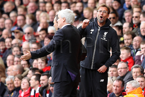 10.04.2016. Anfield, Liverpool, England. Barclays Premier League. Liverpool versus Stoke. Jurgen Klopp, Liverpool manager argues with Mark Hughes,manager of Stoke City in the technical area.
