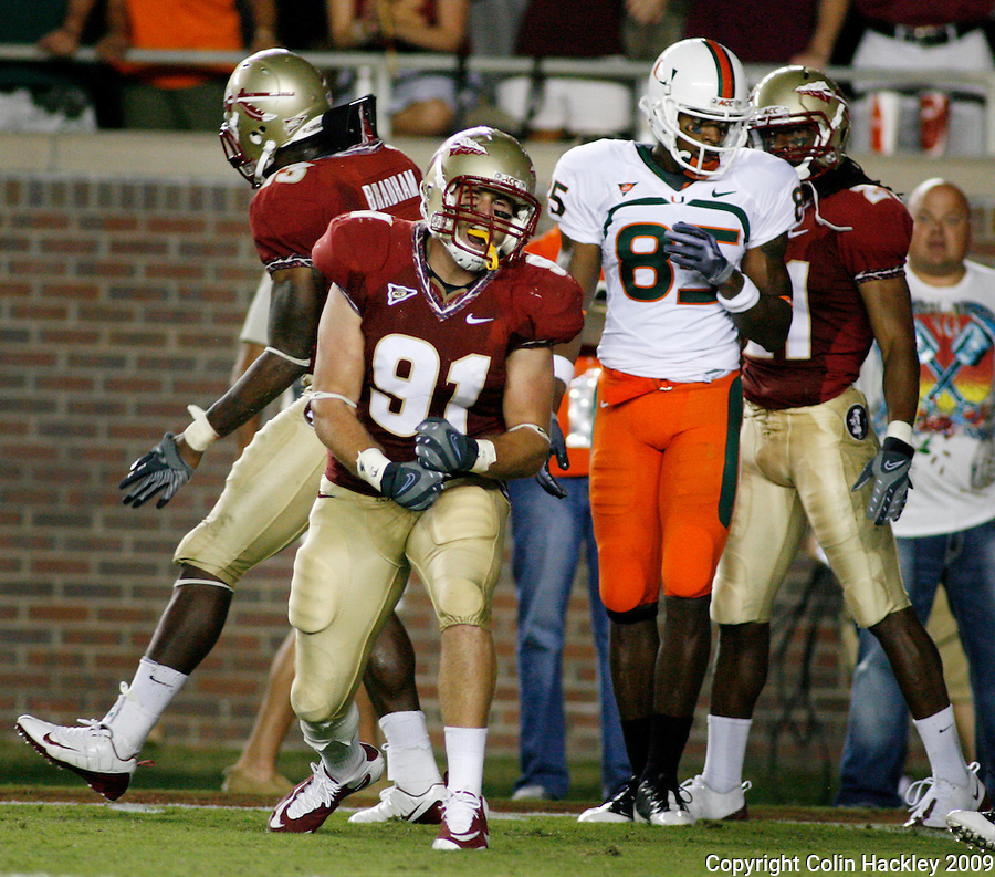 TALLAHASSEE, FL 9/7/09-FSU-MIAMIFB09 CH26-Florida State's Nigel Bradham, left, and Craig Yarborough celebrate a goal line stand against Miami's during second half action Monday at Doak Campbell Stadium in Tallahassee. The Seminoles lost to the Hurricanes 38-34...COLIN HACKLEY PHOTO