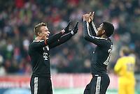 FUSSBALL   CHAMPIONS LEAGUE   SAISON 2012/2013   GRUPPENPHASE   FC Bayern Muenchen - FC Bate Borisov              05.12.2012 Jubel nach dem Tor zum 4:0 Xherdan Shaqiri und David Alaba (v. li., FC Bayern Muenchen)