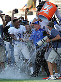 Armwood Hawks wide receiver Alvin Bailey celebrates as teammates dump the water over head coach Sean Callahan during the fourth quarter of the Florida High School Athletic Association 6A Championship Game at Florida's Citrus Bowl on December 17, 2011 in Orlando, Florida.  Armwood defeated Miami Central 40-31.  (Photo By Mike Janes Photography)
