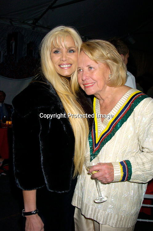 Victoria Gotti and Liz Smith..at The Fete de Swifty benefitting the Parks Afterschool Program of the Mayor's Fund to Advance New York City..on October 4, 2004 in a tent on 73rd Street. ..Photo by Robin Platzer, Twin Images