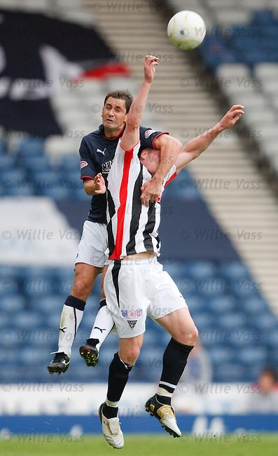 Jamie Mole can't jump as Jackie McNamara smothers him