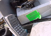 A sticker advises that an old scanner is to picked up by a recycling company. The scanner was found in a pile of electronic trash imported to China from the United States.