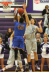 SIOUX FALLS, SD - NOVEMBER 24: Miguel Sansavour #45 from Dakota State University looks for the jumper as Bryan Kielpinski #52 from the University of Sioux Falls  defends in the first half of their game Monday night at the Stewart Center.  (Photo by Dave Eggen/Inertia)