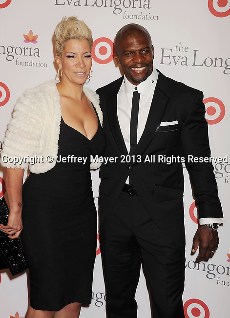 HOLLYWOOD, CA- SEPTEMBER 28: Actor Terry Crews (R) and wife Rebecca King-Crews arrive at the Eva Longoria Foundation Dinner at Beso restaurant on September 28, 2013 in Hollywood, California.