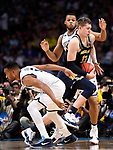 SAN ANTONIO, TX - APRIL 02: Moritz Wagner #13 of the Michigan Wolverines drives to the basket against Villanova Wildcats during the second half in the 2018 NCAA Men's Final Four National Championship game at the Alamodome on April 2, 2018 in San Antonio, Texas.  (Photo by Jamie Schwaberow/NCAA Photos via Getty Images)