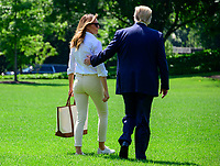 First lady Melania Trump joins United States President Donald J. Trump on the South Lawn of the <br /> White House in Washington, DC after he made remarks and answered reporter's questions as he prepares to depart on Friday, July 5, 2019.  The President will travel to Westminster, New Jersey for the weekend.<br /> CAP/MPI/RS<br /> ©RS/MPI/Capital Pictures