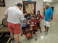 NWA Democrat-Gazette/ANTHONY REYES &bull; @NWATONYR<br /> James Dean, left, hands a basketball donation to students from Jones Elementary School with Jon Dellinger, both with the Springdale Basketball Association, Friday, Sept. 4, 2015 at the Elementary School in Springdale. The association donated approximately 60 basketballs to elementary schools in Springdale.