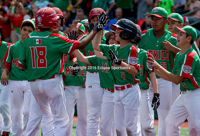 Aberdeen, MD - JULY 31: Jesus Morales #18 of Mexico is congratulated by his team after hitting a 2 run home run during the game between the Republic of Korea and Mexico during the Cal Ripken World Series at The Ripken Experience Powered by Under Armour on July 31, 2016 in Aberdeen, Maryland. (Photo by Ripken Baseball/Eclipse Sportswire/Getty Images)