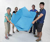 OrigamiUSA 2016 Convention at St. John's University, Queens, New York, USA. Oversized 9' x 9' paper folding event. First timers. Left to right: Patsy Wang-Iverson, NJ, unknown, unknown, Matthew Gong, UT.