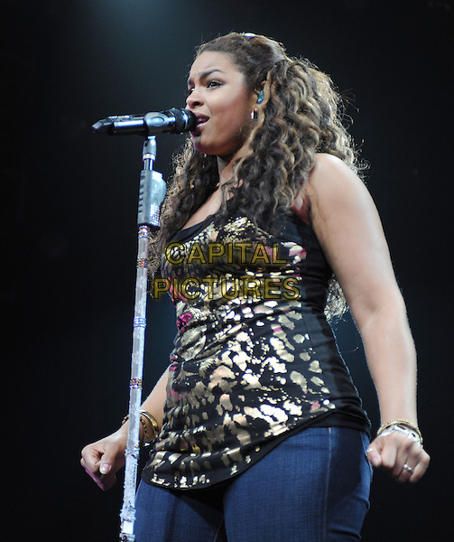 JORDIN SPARKS .performs live during The Battlefield Tour held at The Grove of Anaheim in Anaheim, California, USA, .July 2nd 2010..half length  music on stage in concert gig                                                                               black gold print vest top jeans microphone singing.CAP/RKE/DVS.©DVS/RockinExposures/Capital Pictures.