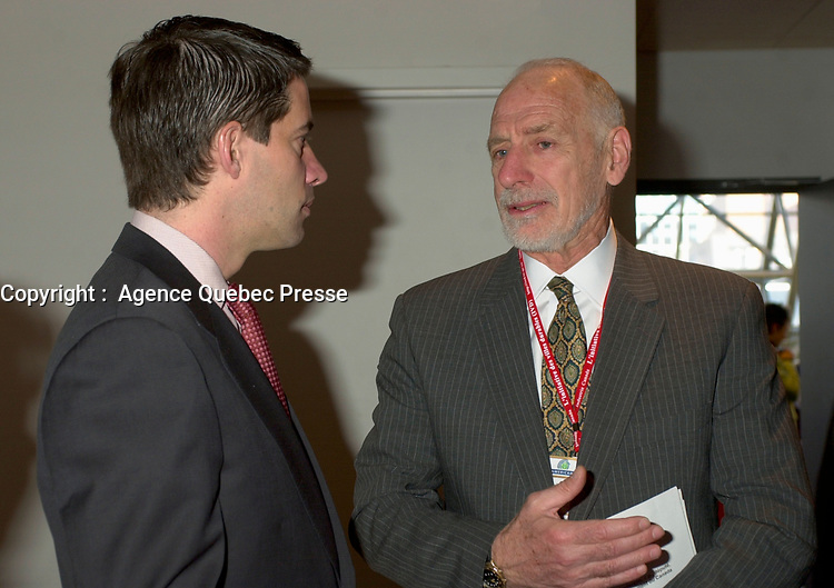 March 19 2003, Montreal, Quebec, Canada<br /> <br />  Andre Boisclair, Quebec's Environment Minister (L) talk with<br /> David Anderson ,Canada's  Environment Minister, (R)  before  the  opening plenary session of Americana ;  a 3 days conference and  trade show on environment and waste management organized by Reseau Environnement, March 19, 2003 in Montreal, Canada.<br /> <br /> Mandatory Credit: Photo by Pierre Roussel- Images Distribution. (©) Copyright 2003 by Pierre Roussel <br /> <br /> Photo :   Pierre Roussel / AGENCE QUEBEC PRESSE