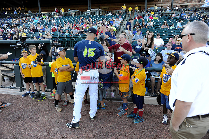 Designated hitter Tim Tebow (15) of the Columbia Fireflies signs autographs before a game against the Lexington Legends on Thursday, June 8, 2017, at Spirit Communications Park in Columbia, South Carolina. Columbia won, 8-0. (Tom Priddy/Four Seam Images)