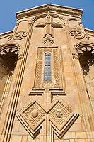 "picture & image of exterior stone work decorations of the Samtavisi Georgian Orthodox Cathedral, 11th century, Shida Karti Region, Georgia (country)<br /> <br /> Built during the so called 10-11th century ""Georgian Golden Era"" Samtavisi cathedral is a built in classical Georgian style of the period. Layout on a cruciform ground plan with a high central cylindrical central cupola."