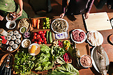 VIETNAM, Hue, an assortment of home grown vegetables and fish and meats from local markets, Ms. Boi Tran and her staff prepare an elaborate meal