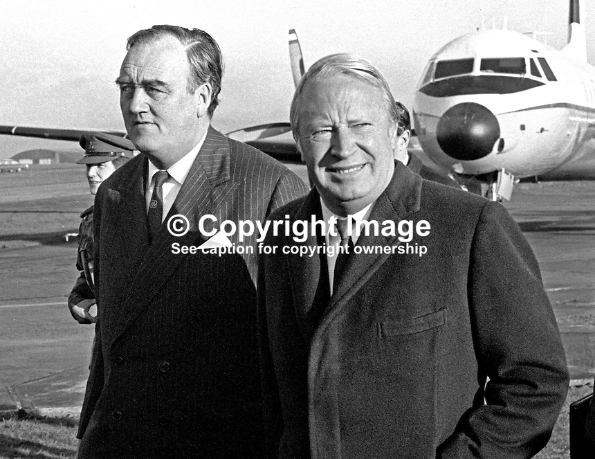 UK Prime Minister Edward Heath, right, on arrival at Belfast International Airport, 16th November 1972, at the start of a two day visit to N Ireland. Accompanying him is William Whitelaw, Secretary of State for N Ireland. 197211160729a.<br />