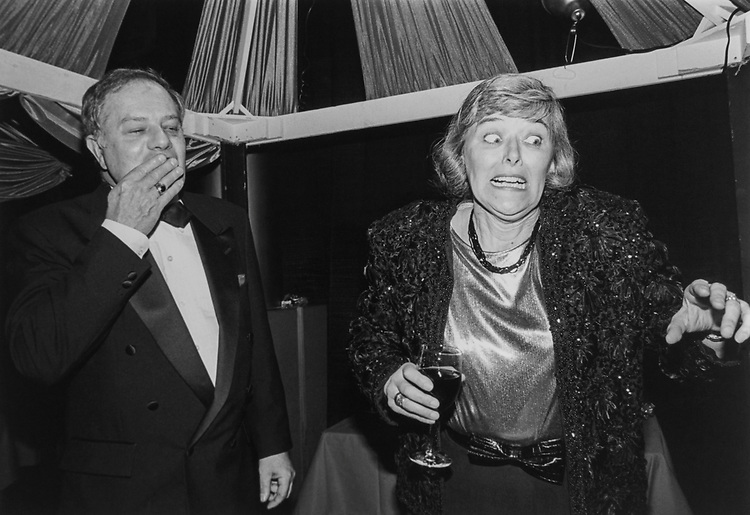 Rep. Patricia Schroeder, D-Colo., describing her cooking to some guests as her husband Jim Schroeder looks on scared on March 22, 1994. (Photo by Laura Patterson/CQ Roll Call)