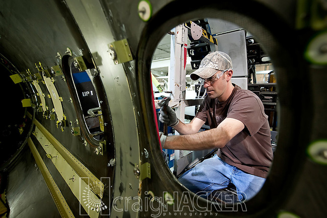 Feb. 19th, 2009 -- Wichita, Kan.-- Hawker Beechcraft employee Eric Hanson works on the assembly of a Hawker 4000 business jet in the company's Wichita, Kan. production facility Thursday, Feb. 19, 2009.