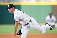 Charlotte Knights starting pitcher Carlos Rodon (41) follows through on his delivery against the Gwinnett Braves at BB&T Ballpark on August 19, 2014 in Charlotte, North Carolina.  The Braves defeated the Knights 10-5.   (Brian Westerholt/Four Seam Images)