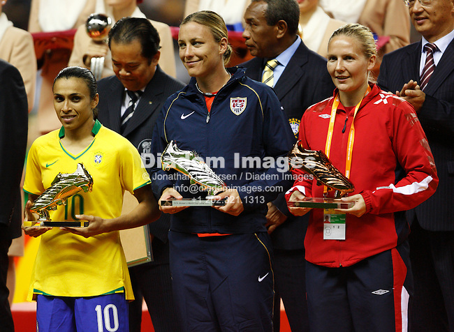 SHANGHAI - SEPTEMBER 30:  Adidas Golden Shoe winners Marta of Brazil (first), Abby Wambach of the United States (second) and Ragnhild Gulbrandsen of Norway (third) (L-R) pose with their trophies during post match ceremonies after the FIFA Women's World Cup soccer final between Brazil and Germany September 30, 2007 in Shanghai, China.  (Photograph by Jonathan P. Larsen)