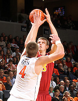 Dec. 30, 2010; Charlottesville, VA, USA; Iowa State Cyclones forward Jamie Vanderbeken (23) shoots over Virginia Cavaliers forward Will Regan (4) during the game at the John Paul Jones Arena. Mandatory Credit: Andrew Shurtleff