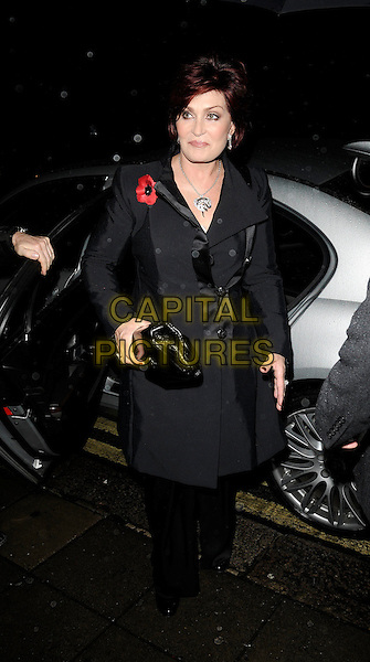 SHARON OSBOURNE  .The Classic Rock Roll Of Honour, Park Lane hotel, Piccadilly, London, England..November 3rd, 2008.full length black trousers clutch bag grey gray coat jacket poppy .CAP/CAN.©Can Nguyen/Capital Pictures.