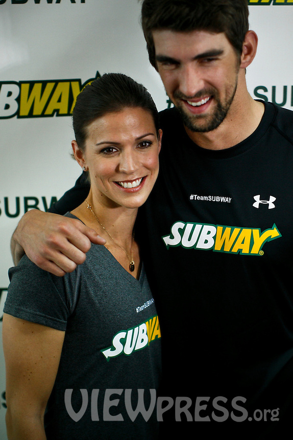 """Olympic medalist Michael Phelps hugs his sisters  Whitney while they attend a event called """"Official Training Restaurant of the Phelps Family"""" to support his sister Whitney as she runs the ING New York City Marathon on November 4.  the event was organized by the food company """"Subway"""" in New York, United States. 15/10/2012. Photo by VIEWpress."""