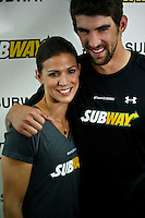 "Olympic medalist Michael Phelps hugs his sisters  Whitney while they attend a event called ""Official Training Restaurant of the Phelps Family"" to support his sister Whitney as she runs the ING New York City Marathon on November 4.  the event was organized by the food company ""Subway"" in New York, United States. 15/10/2012. Photo by VIEWpress."