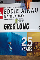 "WAIMEA BAY, Oahu/Hawaii (Tuesday, December 8, 2009) Greg Long's check. - The Quiksilver In Memory of Eddie Aikau,  was officially  called ""ON"" by Contest Director George Downing this morning. The ASP specialty sanctioned event kicked off at 8am with wave face heights in the 25-35-foot range..Nine times world champion Kelly Slater (USA) led for most of the day until Greg Long(USA) scored his best four scoring rides in the last heat of the day to over take Slater. Long scored a perfect 100 point wave late in the day to seal the first prize purse of $55,000. Slater was runner up with Sunny Garcia (HAW) in 3rd, defending champion Bruce Irons (HAW) 4th and Ramon Navarro (CHL)  in 5th place. Navarro won the Monster drop award for the biggest drop, also in the final heat of the day when wave faces were pushing 40' plus...The northern hemisphere winter months on the North Shore signal a concentration of surfing activity with some of the best surfers in the world taking advantage of swells originating in the stormy Northern Pacific. Notable North Shore spots include Waimea Bay, Off The Wall, Backdoor, Log Cabins, Rockpiles and Sunset Beach... Ehukai Beach is more  commonly known as Pipeline and is the most notable surfing spot on the North Shore. It is considered a prime spot for competitions due to its close proximity to the beach, giving spectators, judges, and photographers a great view...The North Shore is considered to be one the surfing world's must see locations and every December hosts three competitions, which make up the Triple Crown of Surfing. The three men's competitions are the Reef Hawaiian Pro at Haleiwa, the O'Neill World Cup of Surfing at Sunset Beach, and the Billabong Pipeline Masters. The three women's competitions are the Reef Hawaiian Pro at Haleiwa, the Gidget Pro at Sunset Beach, and the Billabong Pro on the neighboring island of Maui...Photo: Joliphotos.com"
