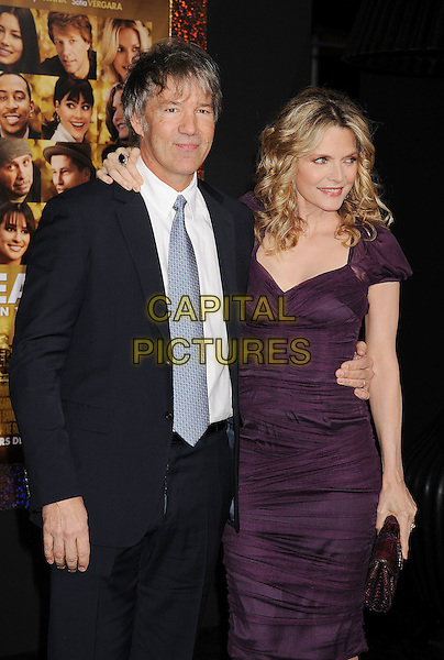 """David E. Kelley & Michelle Pfeiffer.The World Premiere of """"New Year's Eve' held at The Grauman's Chinese Theatre in Hollywood, California, USA..December 5th, 2011.half length dress purple clutch bag black blue suit white shirt tie married husband wife   .CAP/ROT/TM.©Tony Michaels/Roth Stock/Capital Pictures"""