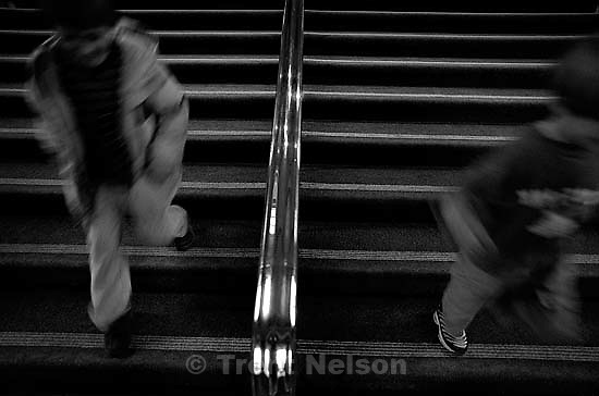 Nathaniel Nelson, Noah Nelson run down a stairway in the Parliament building (3 photos)<br />