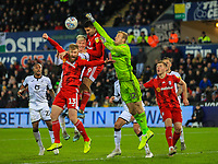 29th November 2019; Liberty Stadium, Swansea, Glamorgan, Wales; English Football League Championship, Swansea City versus Fulham; Marek Rodak of Fulham  punches the ball clear - Strictly Editorial Use Only. No use with unauthorized audio, video, data, fixture lists, club/league logos or 'live' services. Online in-match use limited to 120 images, no video emulation. No use in betting, games or single club/league/player publications