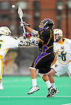 10 April 2011: University at Albany Great Dane midfielder Daley Baker, a Junior from Cleveland Heights, Ohio, in action against the University of Vermont Catamounts on Moulton Winder Field in Burlington, Vermont. The Catamounts defeated the visiting Danes 11-6 in America East play. Mandatory Credit: Ed Wolfstein Photo
