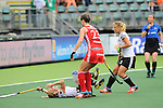 The Hague, Netherlands, June 10: Lydia Haase #12 of Germany reacts to a missed chance to score during the field hockey group match (Women - Group B) between USA and Germany on June 10, 2014 during the World Cup 2014 at Kyocera Stadium in The Hague, Netherlands. Final score 1-3 (0-0) (Photo by Dirk Markgraf / www.265-images.com) *** Local caption *** Lydia Haase #12 of Germany, Sally Walton #23 of England, Eileen Hoffmann #11 of Germany