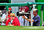 25 April 2010: Washington Nationals' team photographer Mitchell Layton (right) and a guest take in game action against the Los Angeles Dodgers at Nationals Park in Washington, DC. The Nationals shut out the Dodgers 1-0 to take the rubber match of their 3-game series. Mandatory Credit: Ed Wolfstein Photo
