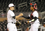 Maryland pitcher Kevin Mooney, left, and Maryland catcher Kevin Martir, right, celebrate after defeating Michigan State 2-1 in a Big 10 tournament baseball game in Minneapolis, Wednesday, May 20, 2015. (Photo/Ann Heisenfelt)