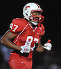 Freeport No. 87 Tyree Powell-Townsend heads back to the sideline after making an interception and returning it for a touchdown in a Nassau County Conference I varsity football game against Massapequa at Freeport High School on Friday, September 25, 2015<br /> <br /> James Escher