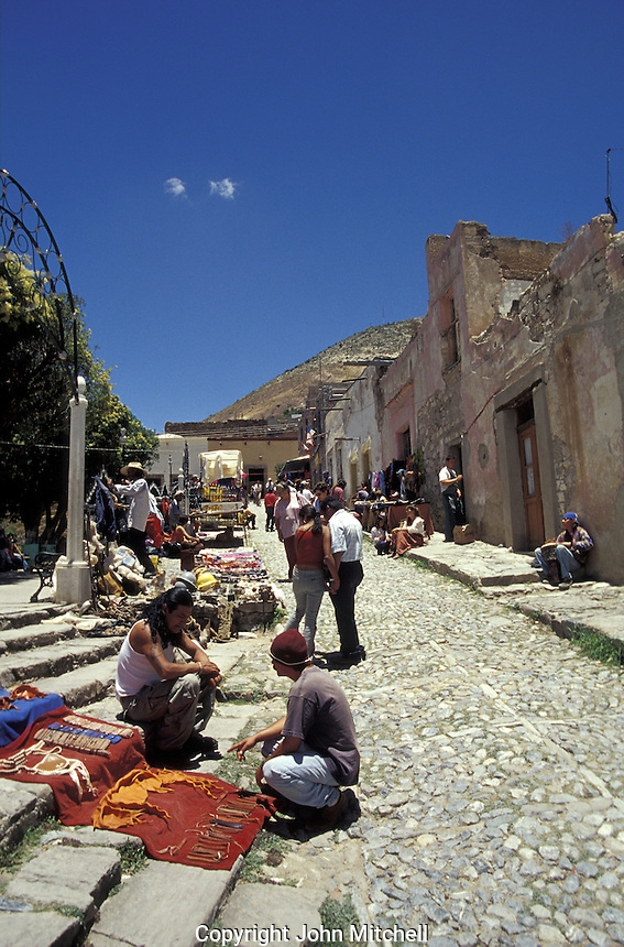 The weekend street market on Calle Hidalgo in the 19th-century silver-mining town of Real de Catorce, San Luis Potosi state, Mexico. Real de Catorce became a virtual ghost town during the early part of the 20th century. It has recently become a popuar destination for travellers.