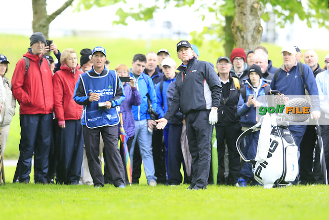 Miguel Angel Jimenez (ESP) and caddy Cliff lines up his 2nd shot on the 17th hole during Thursday's Round 1 of the 2016 Dubai Duty Free Irish Open hosted by Rory Foundation held at the K Club, Straffan, Co.Kildare, Ireland. 19th May 2016.<br /> Picture: Eoin Clarke | Golffile<br /> <br /> <br /> All photos usage must carry mandatory copyright credit (&copy; Golffile | Eoin Clarke)