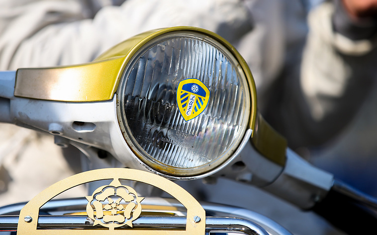 Detail of a Leeds United fans' Vespa motorbike, outside Elland Road<br /> <br /> Photographer Alex Dodd/CameraSport<br /> <br /> The EFL Sky Bet Championship - Leeds United v Millwall - Saturday 30th March 2019 - Elland Road - Leeds<br /> <br /> World Copyright © 2019 CameraSport. All rights reserved. 43 Linden Ave. Countesthorpe. Leicester. England. LE8 5PG - Tel: +44 (0) 116 277 4147 - admin@camerasport.com - www.camerasport.com