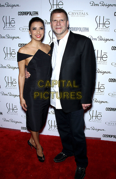 Eva Longoria, Tilman Fertitta.Grand Opening of SHe by Morton's inside Crystals at City Center, Las Vegas, NV, USA, 2nd February 2013..full length black off the shoulders dress pointed side boob white shirt suit .CAP/ADM/MJT.© MJT/AdMedia/Capital Pictures.